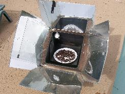 Drying olives in solar oven with door open